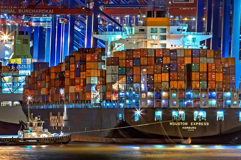 Container Ship Hamburg Express as Symbol for Docker Container Management with Kubernetes